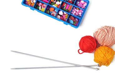 Spokes for knitting, a box with accessories on a white background.