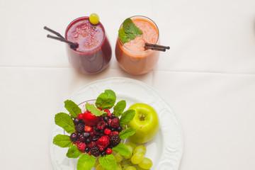 Healthy red smoothies and ingredients - superfoods, detox, diet, health, vegetarian food concept.