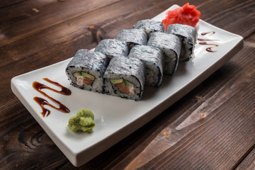 Roll made of Fresh Salmon, Smoked Eel, Cream Cheese and Cucumber inside. Topped with Smoked Eel unagi