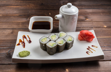 Japanese cuisine. Sushi roll with avocado on white background