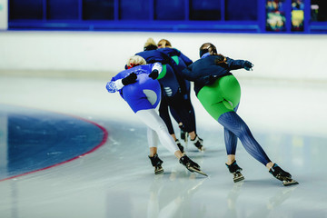 group women speed skaters on warm-up competition in speed skating