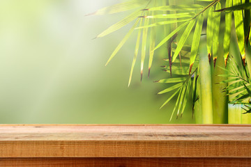 Beautiful bamboo nature background and wooden table.