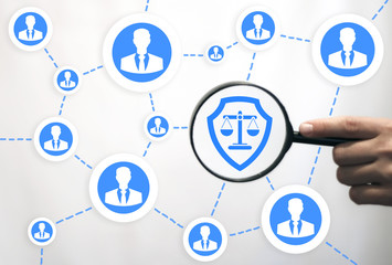 Justice and law business concept. Protection, security people web network. Hand keep magnifier with shield scales icon on virtual screen. Safety teamwork, internet. Judicial social protect technology