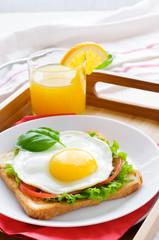 Toast with fried egg, and orange juice