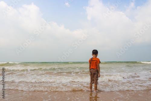 Sad boy on the beach.