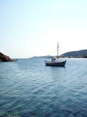 old wood sailboat in Mediterranean Sea Faros harbor on Greek Island of Sifnos