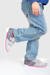 Young girl standing on one foot