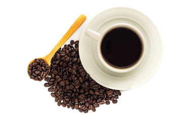 A cup of coffee and coffee beans in wooden spoon isolated on white background.