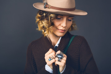 Fashion lifestyle portrait of sensual beautiful young woman in hat, natural beauty face, skin care, bright sexy make up, traveling mood,curly hair,stylish look,red lips,beauty make up