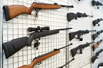 Air guns on stand in shop