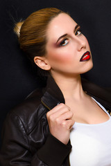 Blonde with professional make-up with dark red lips on a dark background