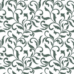 Elegant seamless pattern. Tracery of swirls and decorative leaves  on a white background. Vintage style. It can be used for printing on fabric, wallpaper, wrapping