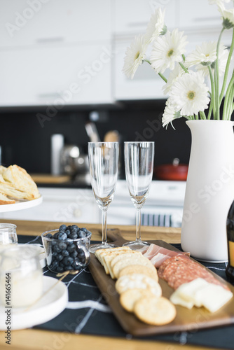 Food With Flower Vase Arranged On Dining Table Stock