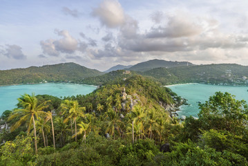 Scenic view of island against cloudy sky