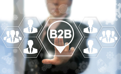B2B concept. Businessman touched b2b location icon on virtual screen. Business to business teamwork technology