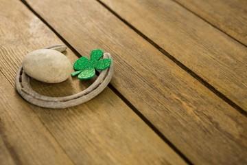 St Patricks Day shamrocks with horseshoe and pebble