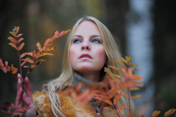 Beautiful blonde in an autumn park