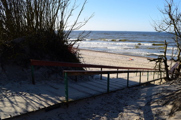 View of wooden steps to the beach near the Pacific ocean in the spring.