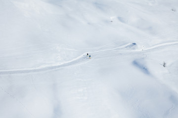Two skiers running on the snowcapped mountains
