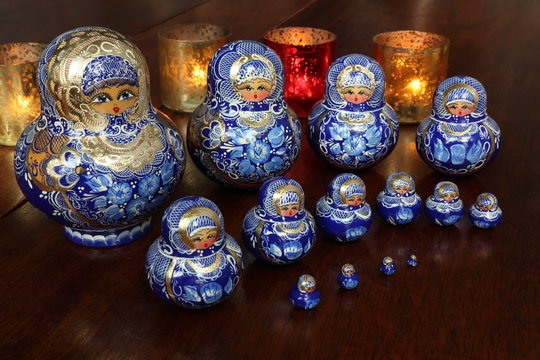 Traditional Russian dolls on wooden table