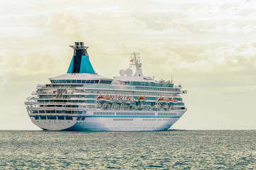 Cruise liner entering Baltic sea. White passenger ship