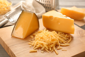 Grated cheese on wooden board