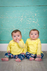 identical twin sisters in matching outfits