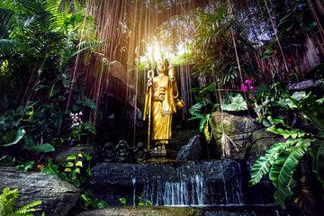 Golden Buddha statue in the garden