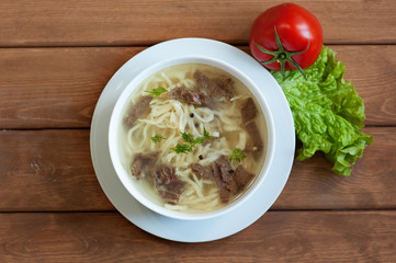 Homemade Noodle Soup on a wooden table