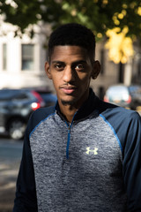 A portrait of a young man on an Autumn day in Central Park - NYC