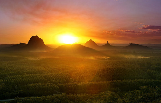Mountains with setting sun and forest foreground, Queensland, Australia.