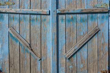 Close up of old barn door painted blue