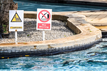 No diving and depth signs in swimmimg pool