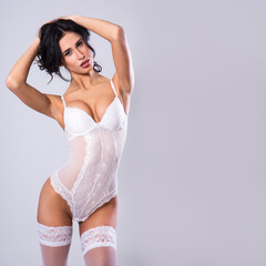 portrait of sexy young woman in white lingerie and space for your text