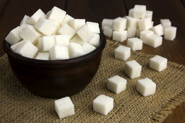 sugar cubes in a pot with a wooden spoon