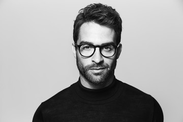 Handsome man in spectacles, portrait Wall mural