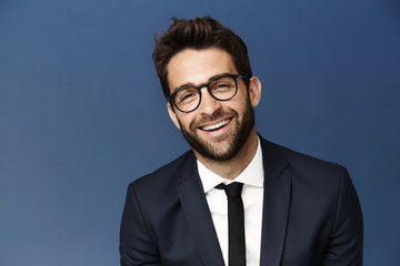 Happy chap in suit and glasses, portrait