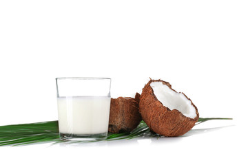 Composition with fresh coconut milk on white background