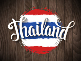Thailand lettering and thai national flag on vintage wooden background. Vector hand drawn typography poster. Retro calligraphic design.