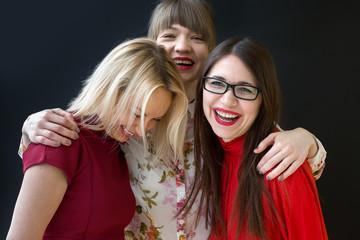 Three laughing female friends