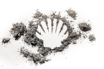 Sea or ocean shell silhouette drawing made in ash, sand, dirt as old fossil, ecology danger, oil and gass resource, marine life concept symbol