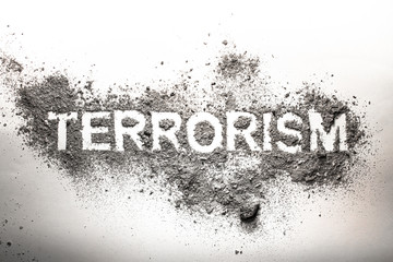 Terrorism word written in ash, dust, dirt as awful, dangerous, frightening, foreboding concept image