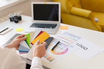 A designer choosing colors