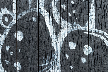 Black wood texture with abstract drawing