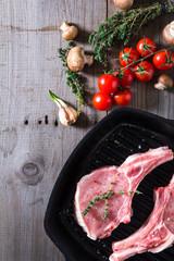 Deurstickers Vlees Raw steaks in grill pan ready to cook