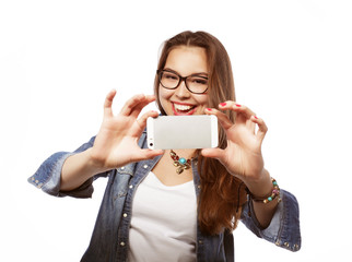 Pretty hipster girl taking selfie. Young and happy.