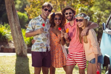 Group of friends enjoying and eating ice lolly