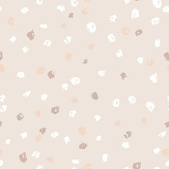 Seamless beige ink dots pattern. Vector grunge background. Vector illustration.
