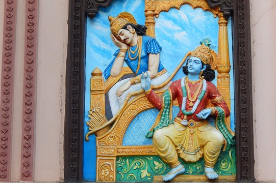 Wall art of Krishna tell Bhagavad gita to Arjuna in Mahabharata war as in Hindu epic in temple