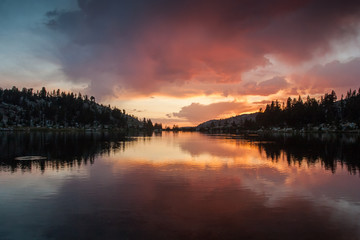 Colorful sunset reflection in a lake in the Sierra Nevada of California
